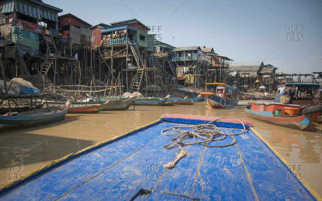 Fishing boats in the harbor of a stilt village, Kampong Pluk, Cambodia