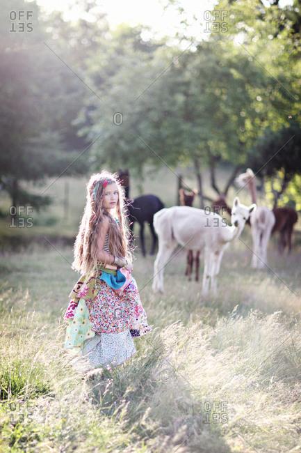 Girl on llama farm
