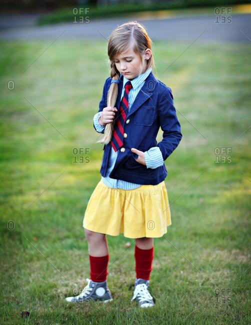 School girl standing in a field
