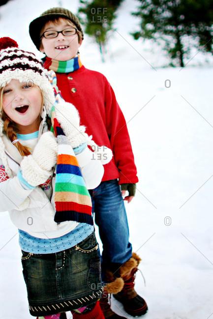 Children girls standing in the snow