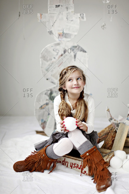 Young girl holding a fake snowball