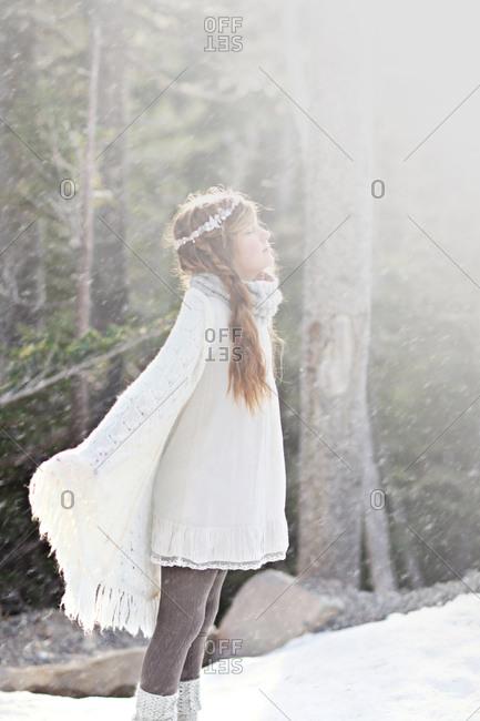 Young girl enjoying the snowfall
