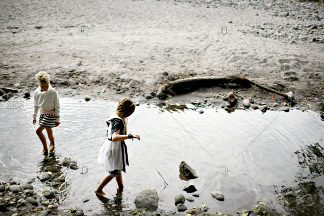 Young girls walking in a stream
