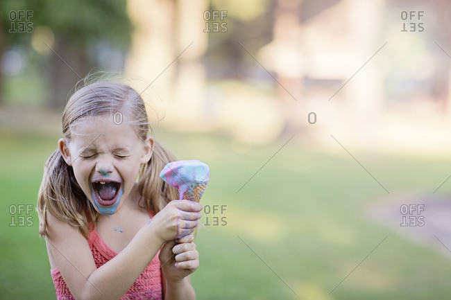 Excited girl eating an ice cream