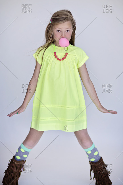Girl blowing a pink bubble gum