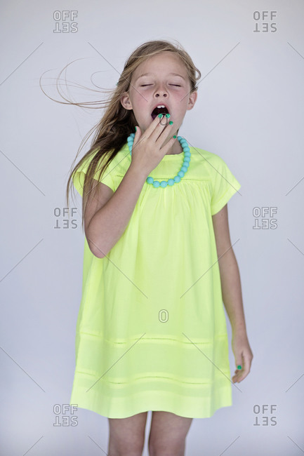 Yawning girl in a dress