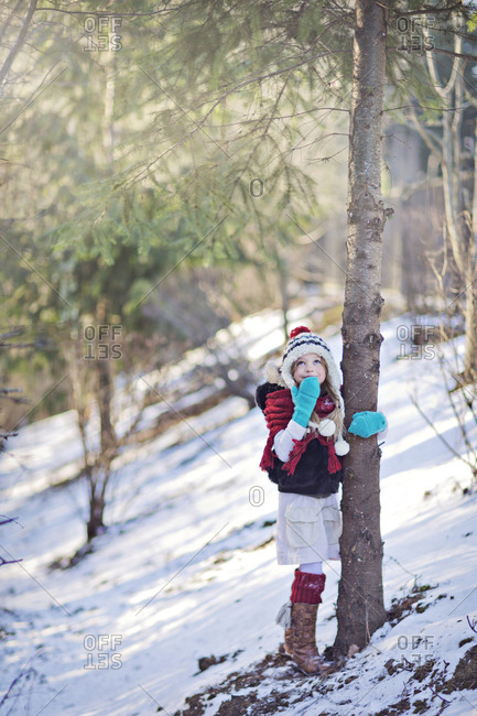 Little girl in a winter forest