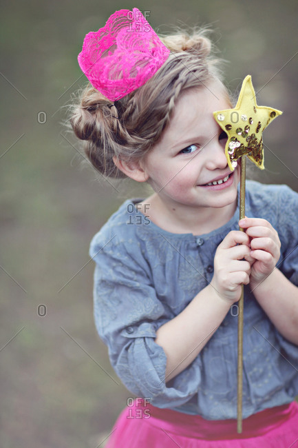 Girl holding a star-shaped wand