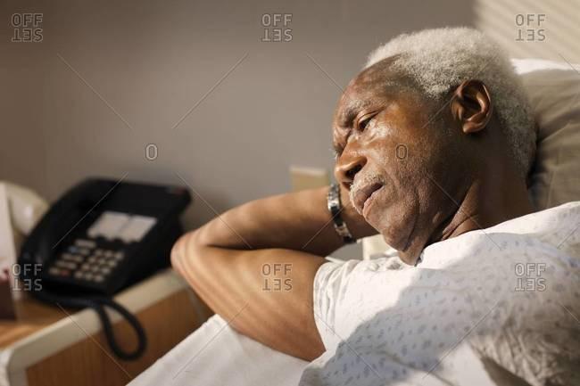 portrait of an elderly man in a hospital