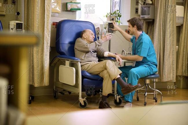 Elderly man receiving intravenous therapy