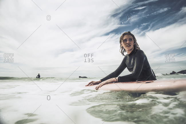 Teenage girl surfing at Atlantic coast