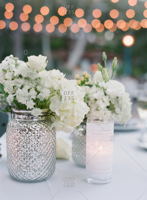 White flower bouquets at a wedding reception