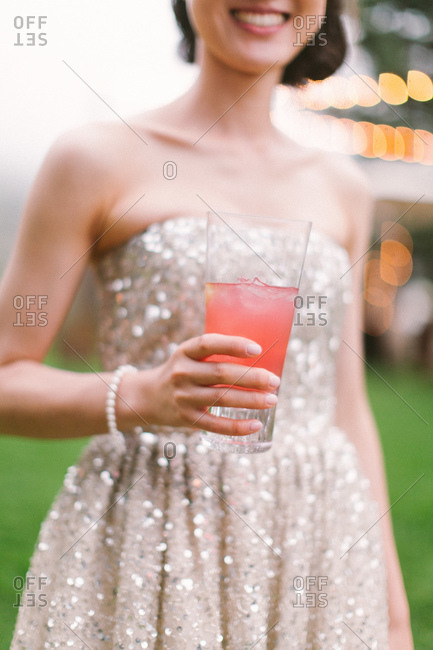 Close up of woman with a cocktail in her hand