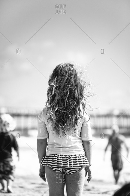 Back view of a girl on a beach