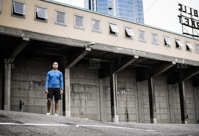 Young man preparing for a jog behind the Park Place Market, Seattle, Washington