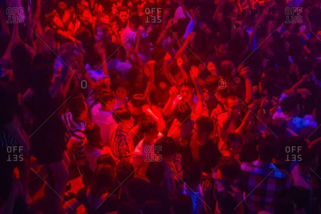 Circa 2014 - Singapore: People dancing in a nightclub