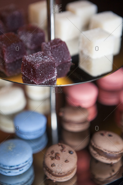 Macarons and jelly cubes on a dessert stand