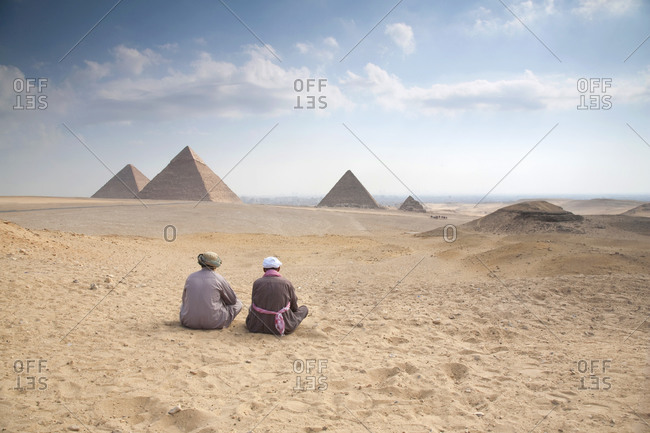 Cairo, Egypt - October 11, 2008: Camel drivers taking a break at the Pyramids