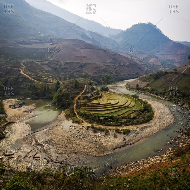 A river wraps around a paddy field