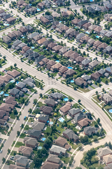 An aerial view of a crowded, upscale subdivision