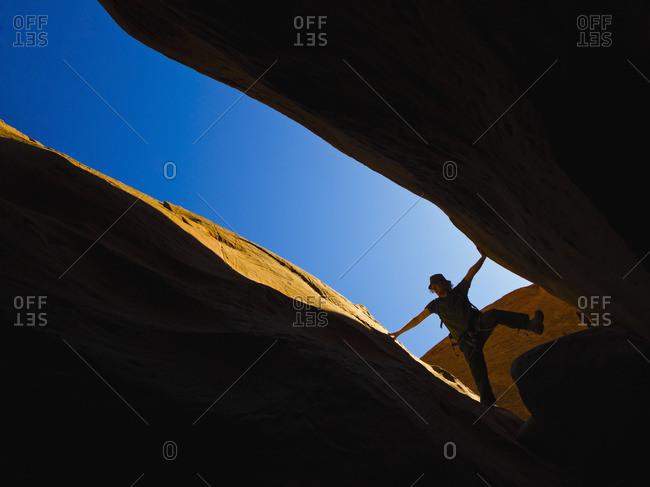 A male athlete exploring Utah Slot Canyons, Hanksville