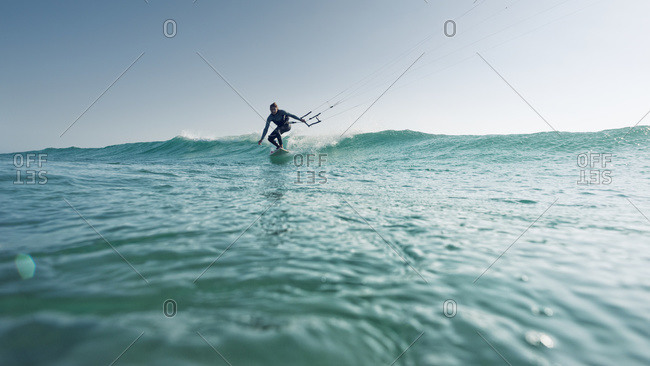 A woman kite surfing