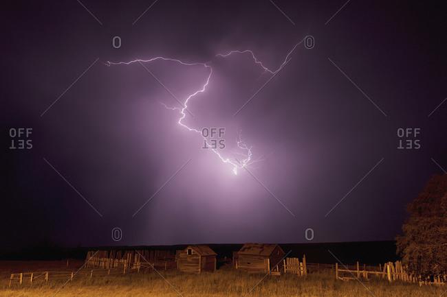 Lightning bolt over some abandoned buildings