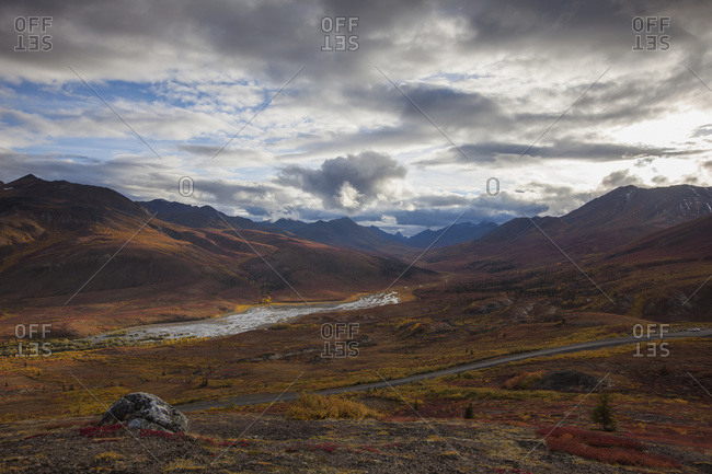The Dempster highway and klondike valley with the tundra covered in autumn colors