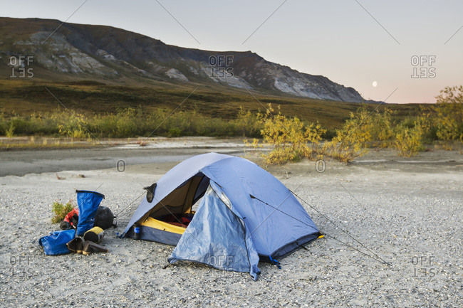 A tent set up with a view of the Brooks Range Gates of the Arctic National Park, Northwestern Alaska