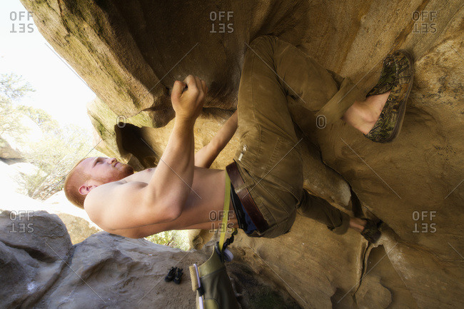 Man rock climbing at lizard's mouth, Santa Barbara, California