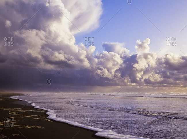 Clouds and tide moving onto the shore along the beach, Oregon