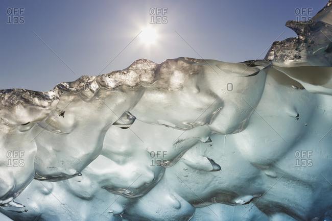 Close up of ice surface of iceberg broken off Mendenhall Glacier floating in Mendenhall lake, Alaska