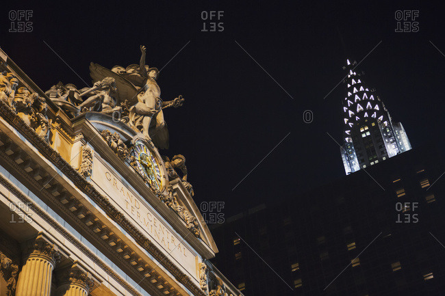 New York, USA - September 17, 2014: The top of Grand Central Station with the Chrysler Building at night