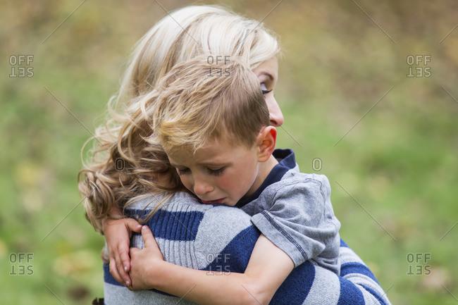A young boy who is hurt and seeks comfort from his mother
