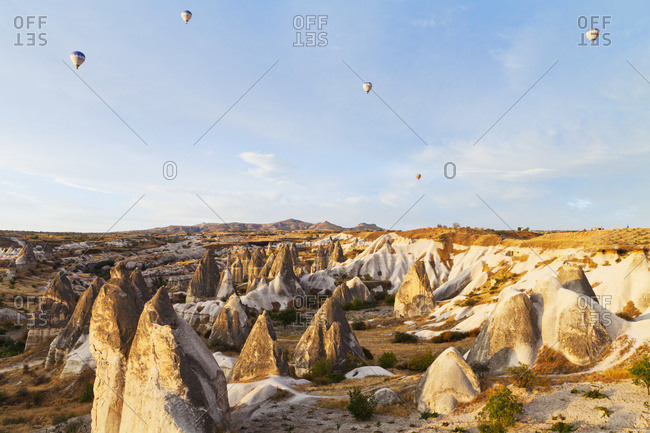 Hot air balloons in the sky above the fairy chimneys, Goreme, Cappadocia, Turkey