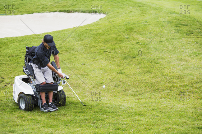 Disabled golfer in a tournament using high tech mobility aid, Edmonton, Alberta,