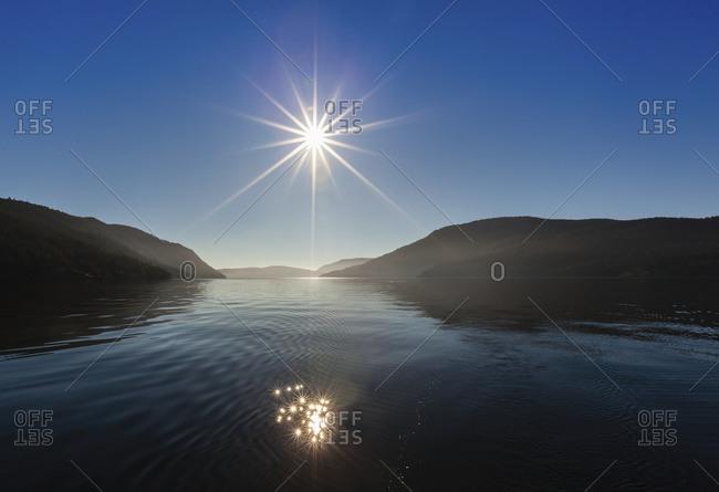 The sun rises over Sansum Narrows on Vancouver Island, Duncan, British Columbia,