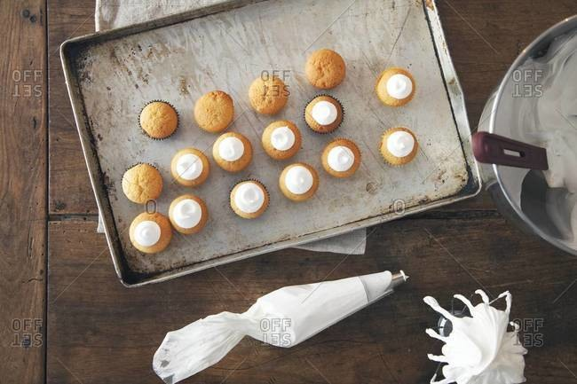 Small homemade cupcakes on a cookie sheet