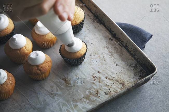 Small homemade cupcakes get frosted
