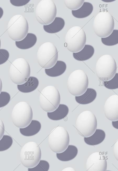Multiple eggs floating over a white background