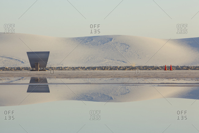 Picnic shelters at a lakeside in a salt pan desert