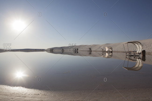 Picnic shelters at a lake in a salt pan desert