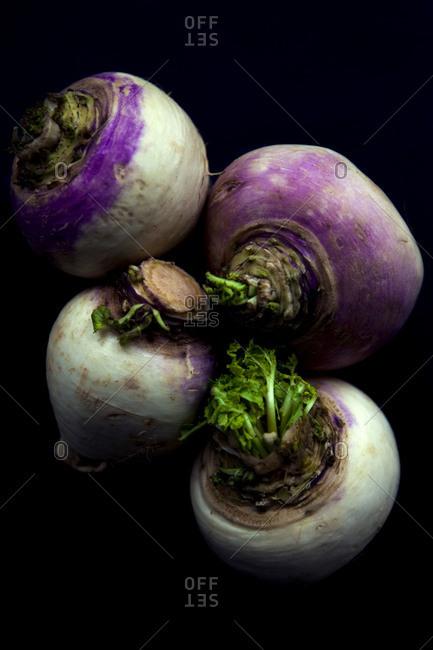 Four turnips nestled together - Offset