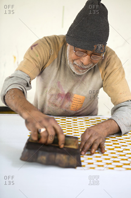 Jaipur, India - January 1, 2014: Man doing hand block printing on fabric in India