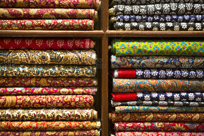 Textiles with different patterns in an emporium in Udaipur, India