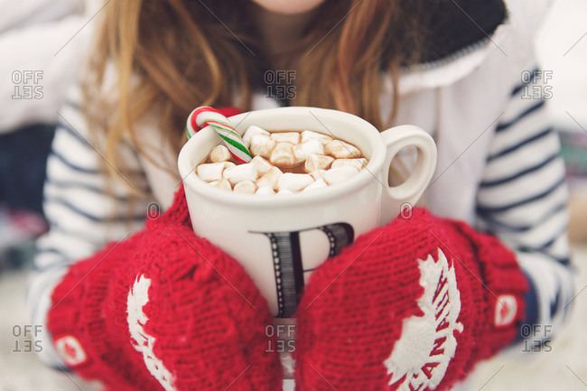 Close up of girl holding a mug of hot chocolate
