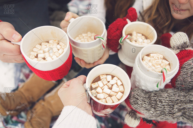 Family toasting with mugs of hot chocolate