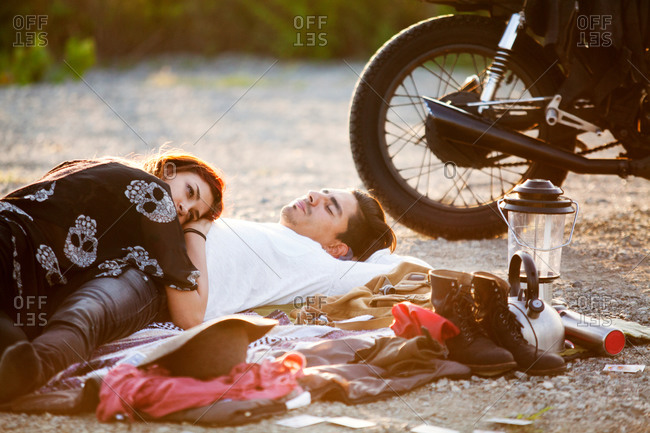 Couple resting on a blanket