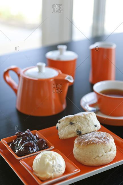 Orange dishware holds breakfast items