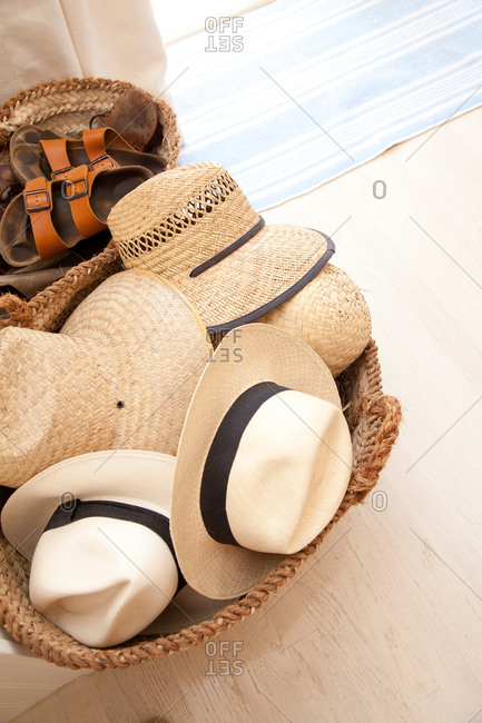 Straw and Panama hats in a basket